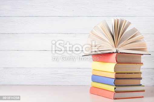 istock Open book, hardback books on wooden table. Education background. Back 591814258