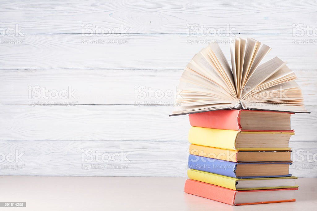 Open book, hardback books on wooden table. Education background. Back stock photo