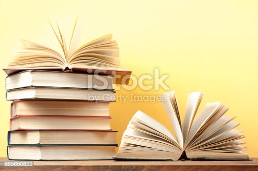 istock Open book, hardback books on wooden table. Education background. Back to school. Copy space for text. 885650822