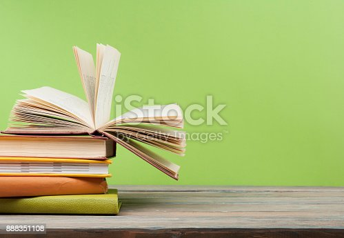 istock Open book, hardback books on wooden table. Education background. Back to school. Copy space for text. 888351108