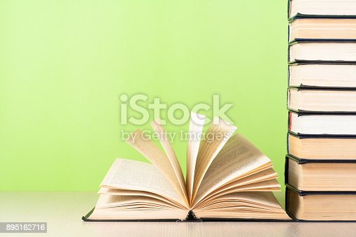 istock Open book, hardback books on wooden table. Education background. Back to school. Copy space for text. 895162716
