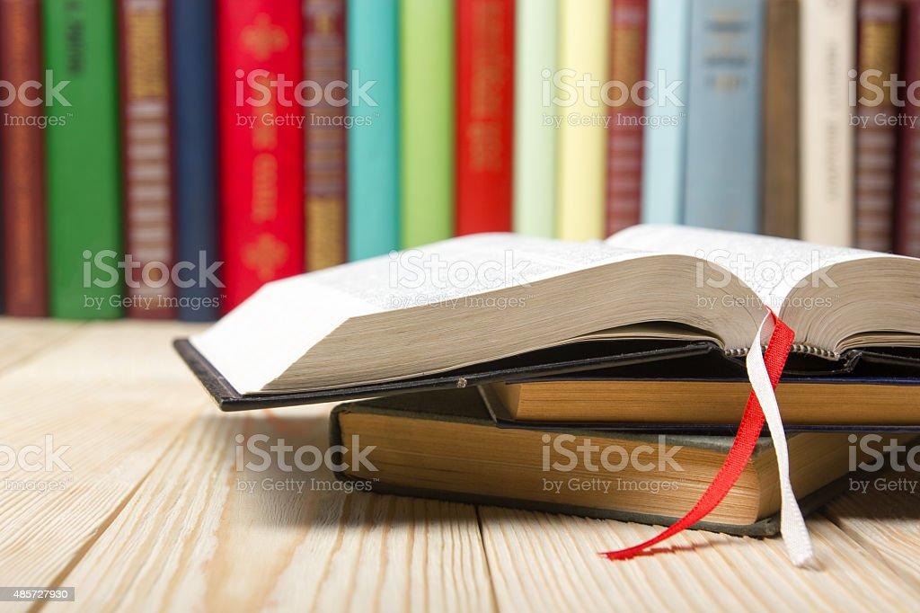 Open book, hardback books on  wooden table stock photo