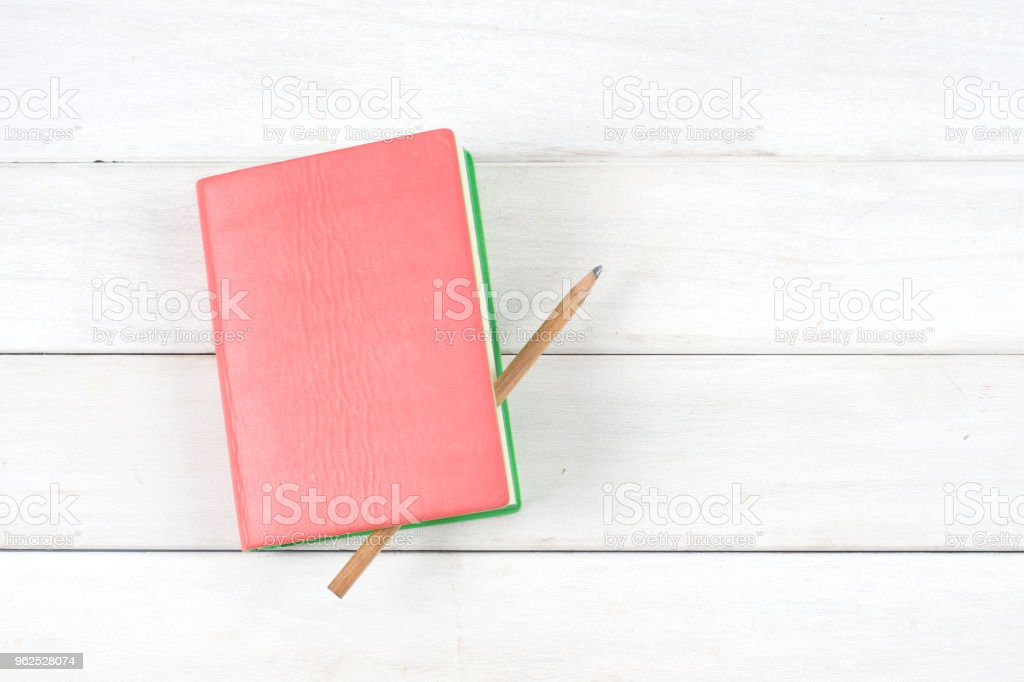 Open book, hardback books on wooden table. - Royalty-free Book Stock Photo
