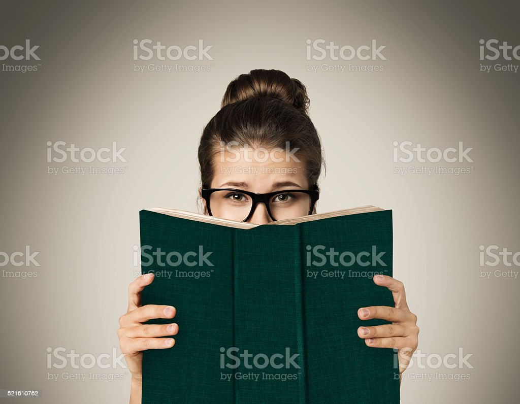 Open Book Hiding Face, Woman Eyes Reading in Glasses, Gray stock photo