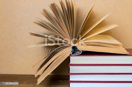 istock open book in hardcover 1155394033