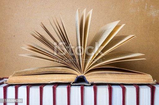 istock open book in hardcover 1155394034