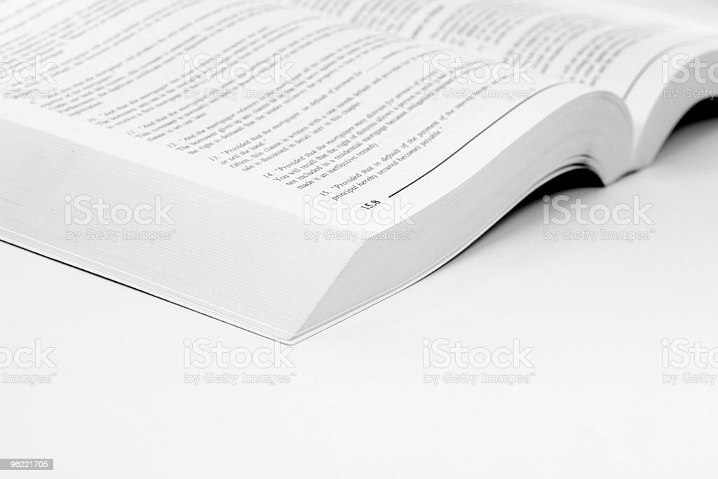 Open book laying on white table  royalty-free stock photo