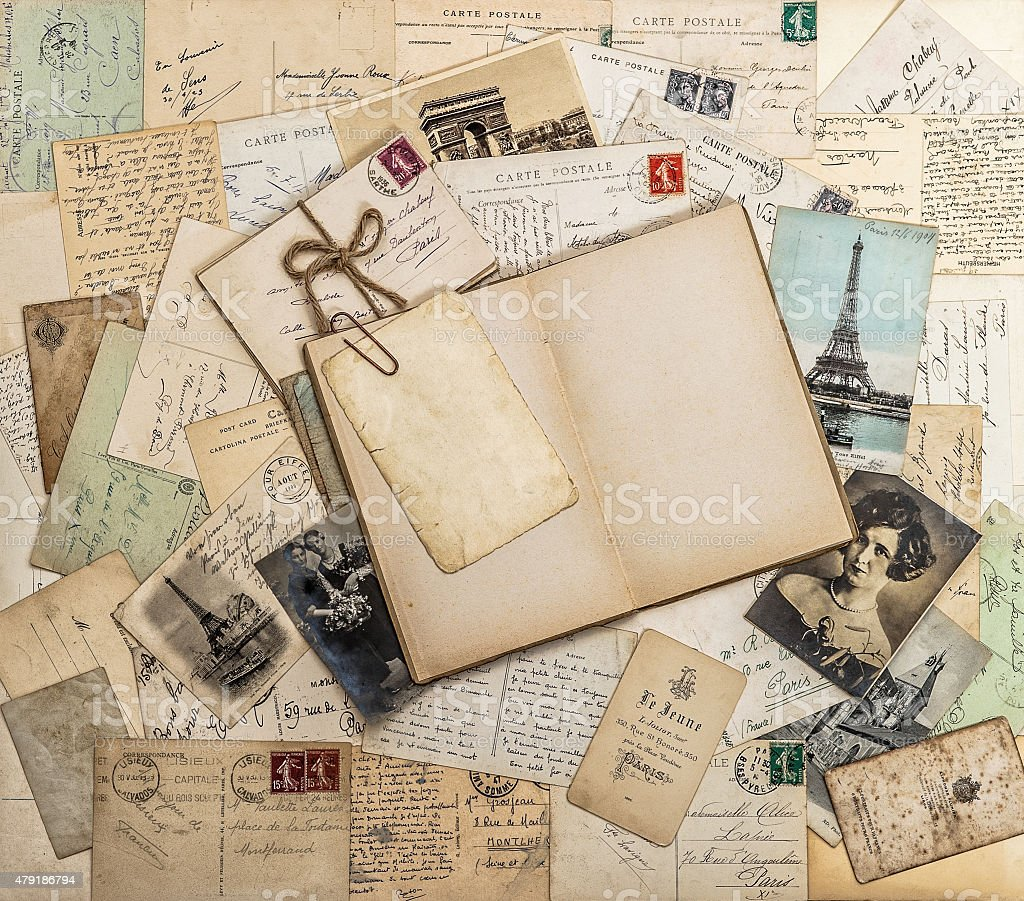 Open book, old letters and postcards. Travel memories scrapbook stock photo