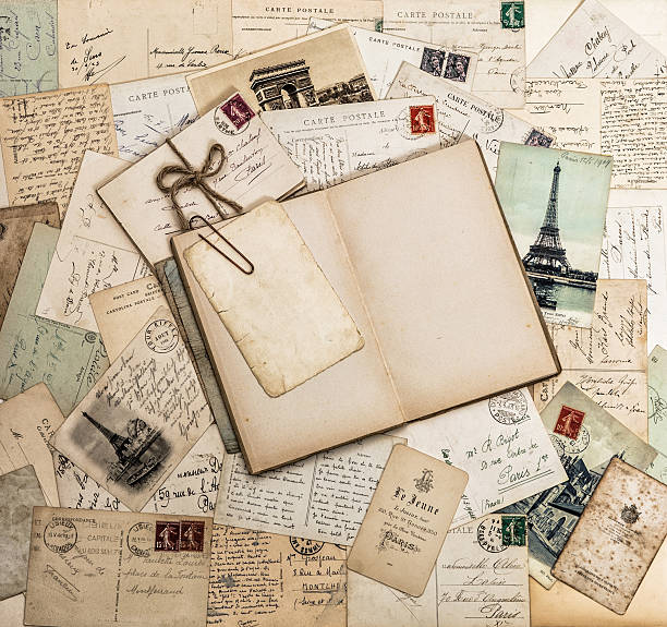 Open book, old letters and postcards. Travel scrapbook France Paris Open book, old letters and postcards. Vintage style paper background. Travel scrapbook for France and Paris 1900 stock pictures, royalty-free photos & images