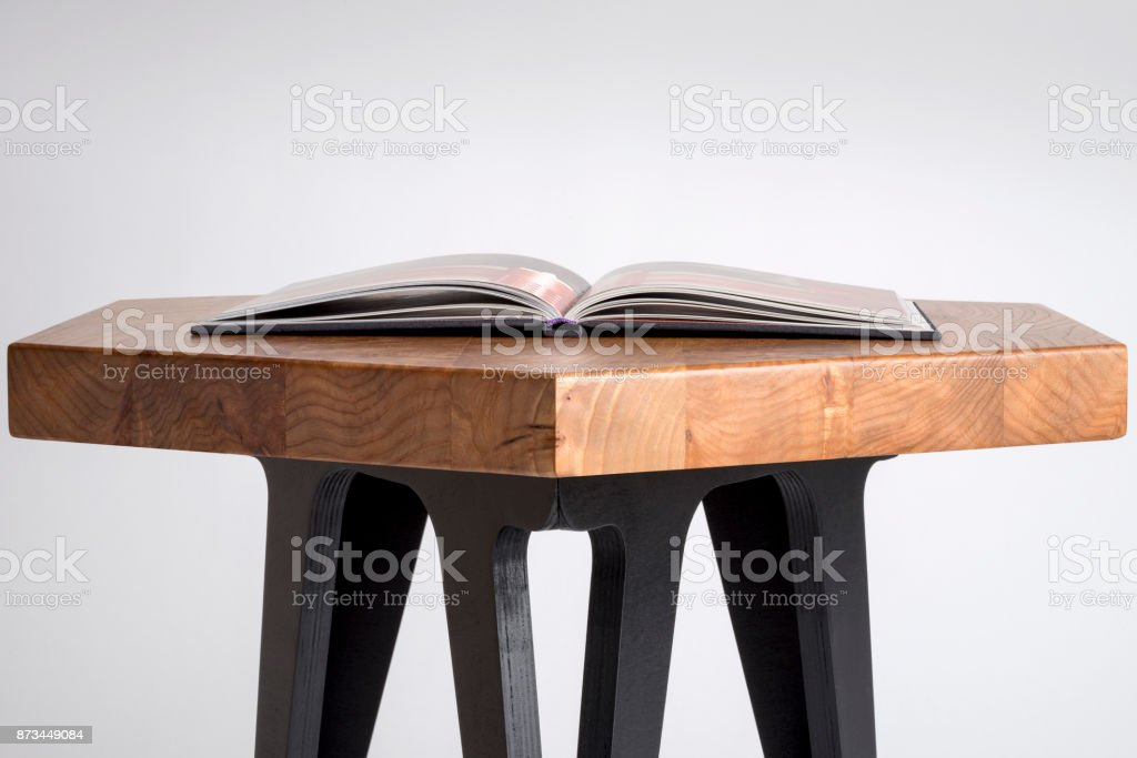 Open Book on a Hexagonal Table on White Background stock photo