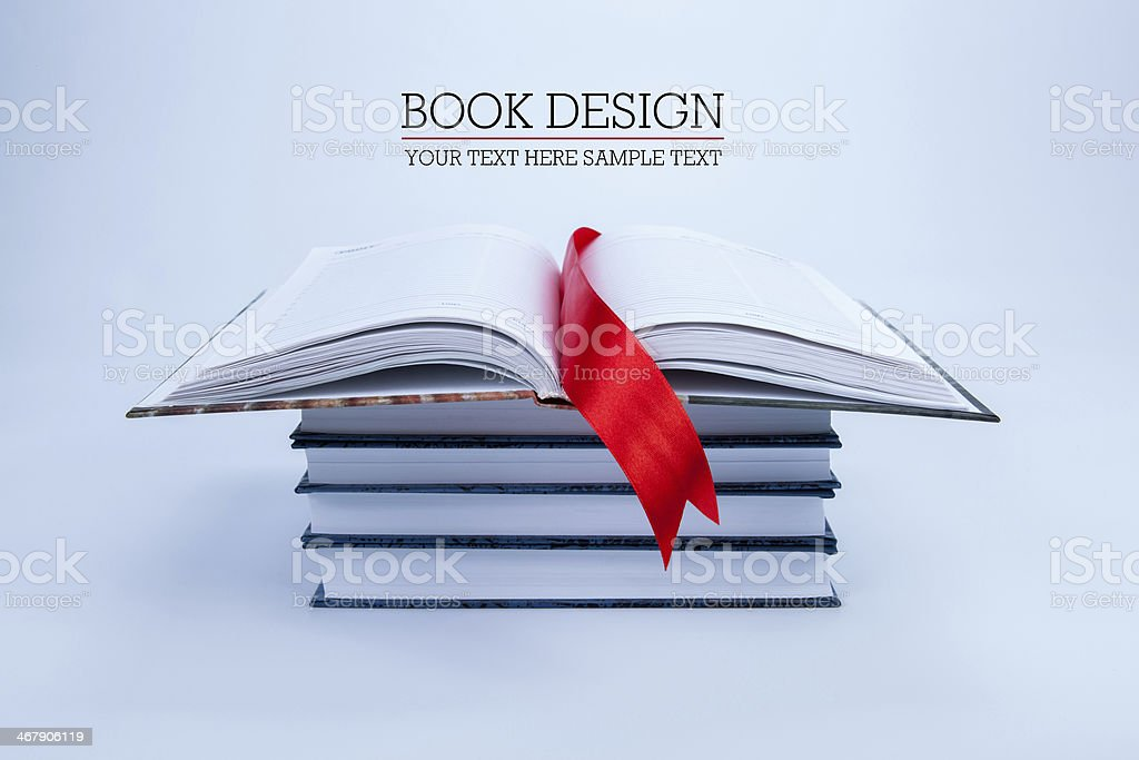 open book on a pile of books stock photo