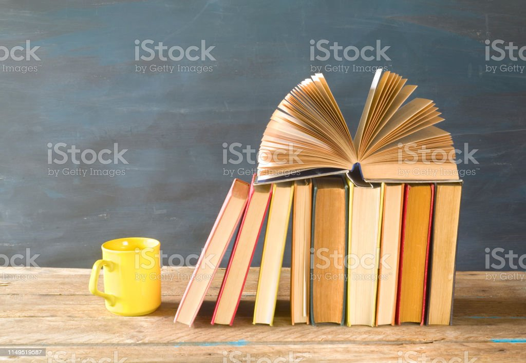 Open Book On A Row Of Books Cup Of Coffee Reading Education