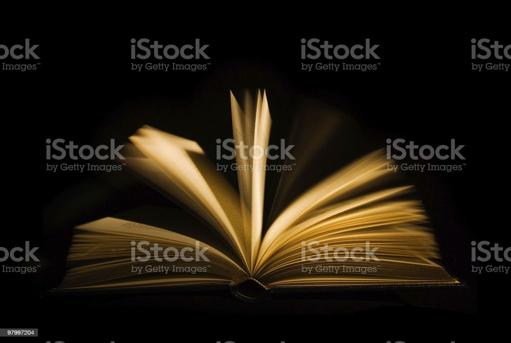 Open book on black background royalty-free stock photo
