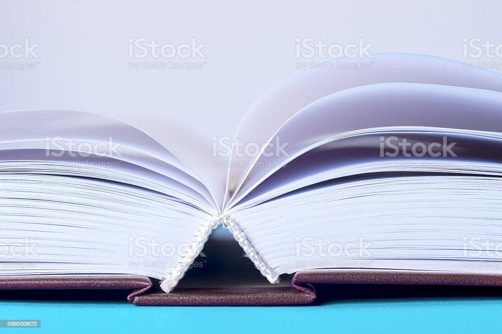 Open book on light table. Back to school. Copy space stock photo