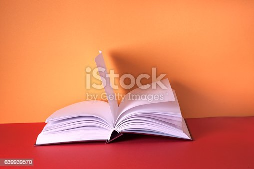 istock Open book on light table. Back to school. Copy space. 639939570