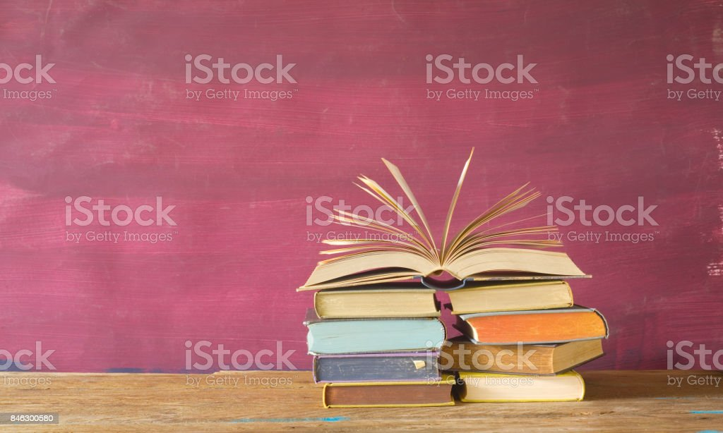 open book on red grungy background, stock photo