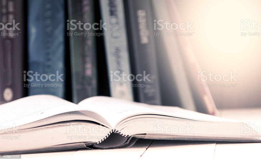 open book on table in vintage color filter stock photo