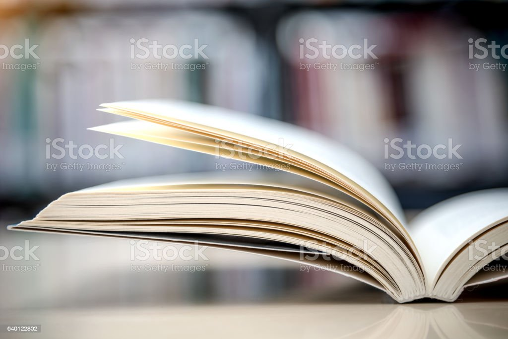 open book on the table in the library stock photo