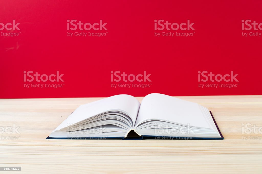Open book on wooden table. Back to school. Copy space. stock photo