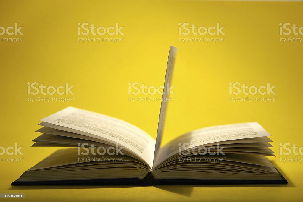 Open book on yellow royalty-free stock photo