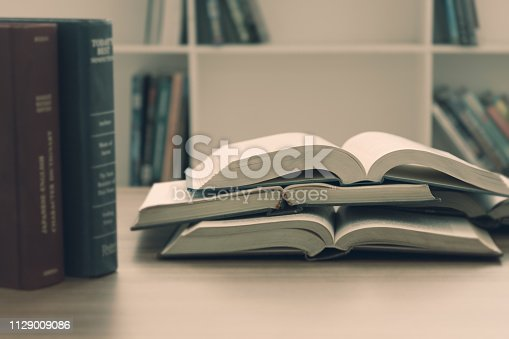 open book on desk in library for reading vintage background. free copy space.