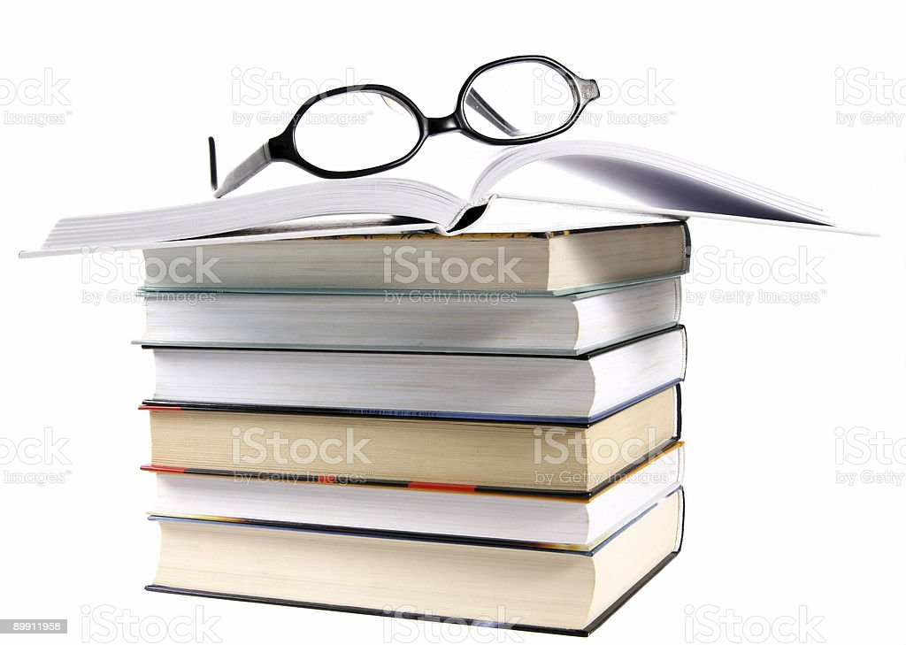 Open book stack and eyeglasses royalty-free stock photo