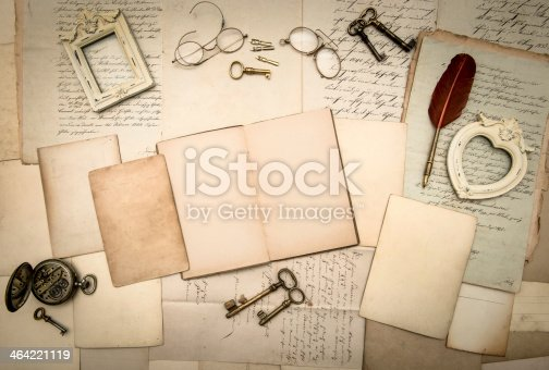 istock open book, vintage accessories, old letters and documents 464221119