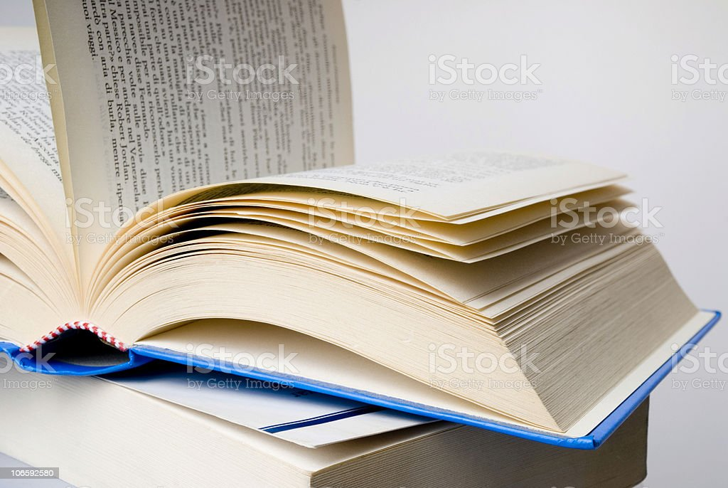 Open book with a blue cover on another book royalty-free stock photo