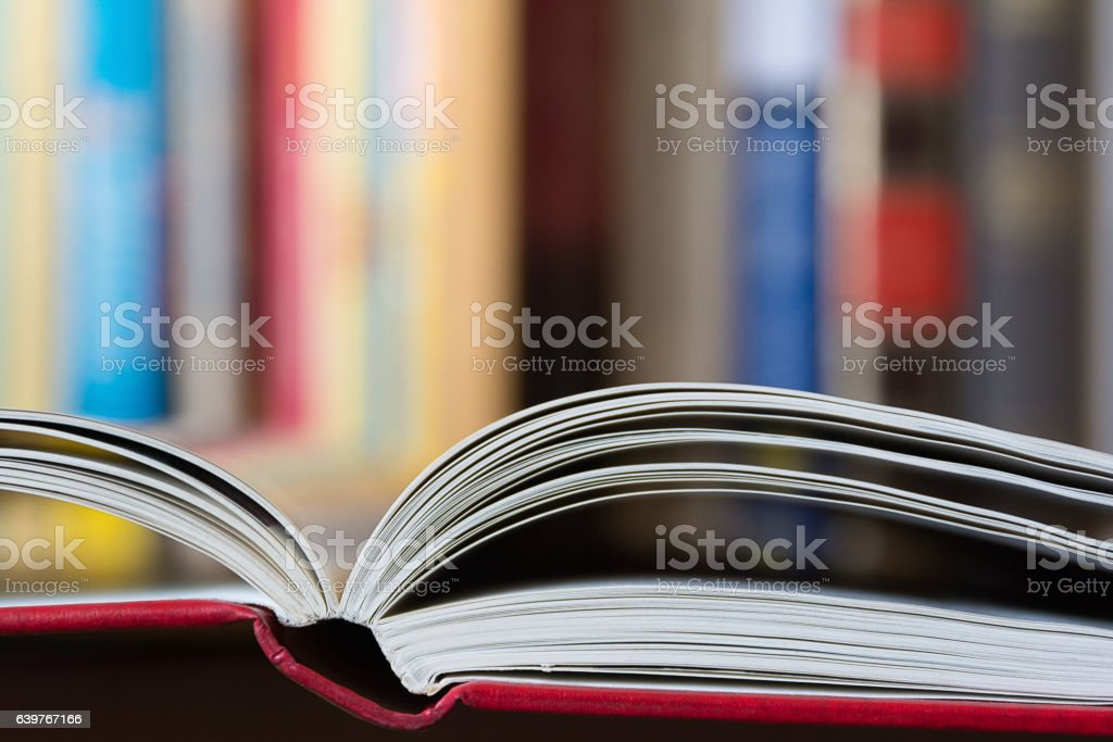 Open book with a library in background stock photo