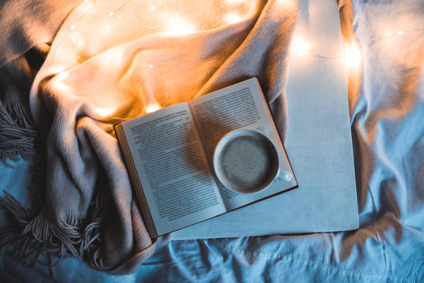Open book with cup of coffee stock photo