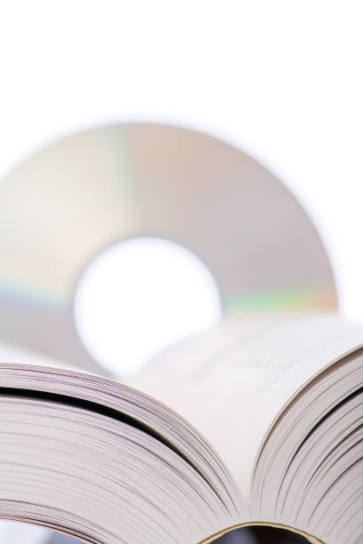 Open Book with DVD stock photo
