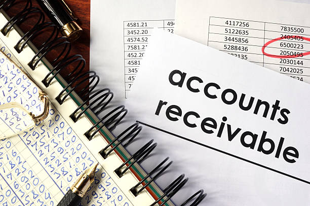 Open book with figures and paper with words  accounts receivable. Open book with figures and paper with words  accounts receivable. accounting ledger stock pictures, royalty-free photos & images