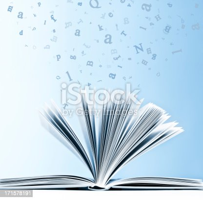 Open book with flying, scattered letters isolated on blue background.