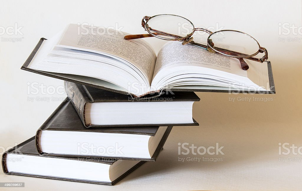 Open book with glasses stock photo