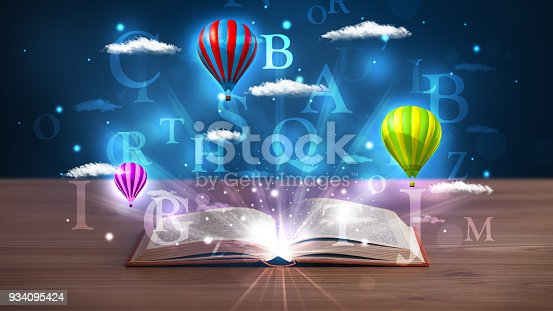 istock Open book with glowing fantasy abstract clouds and balloons 934095424