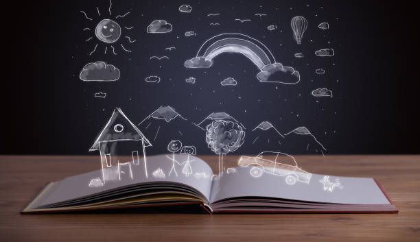 Open book with hand drawn landscape stock photo