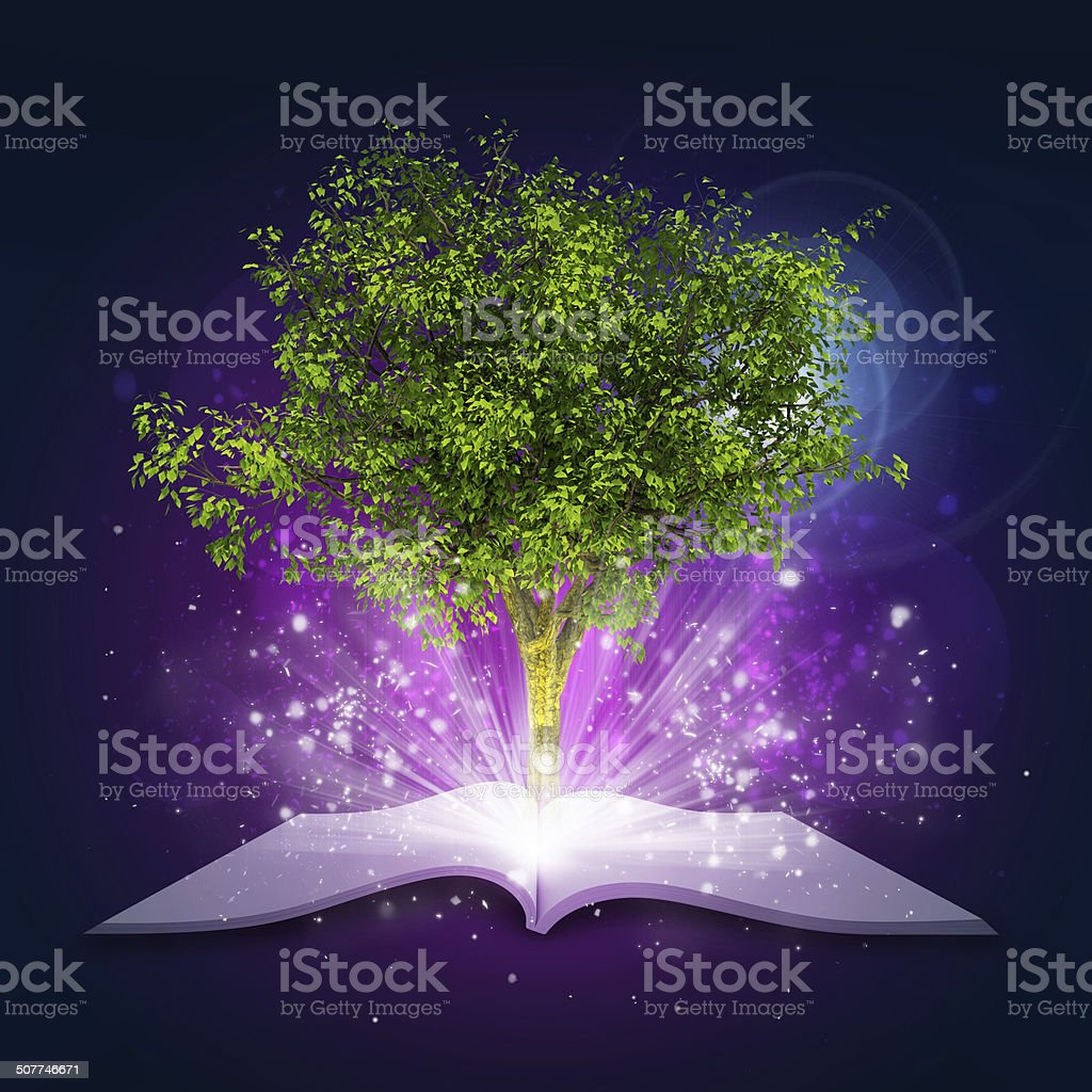 Open book with magical green tree and rays of light stock photo