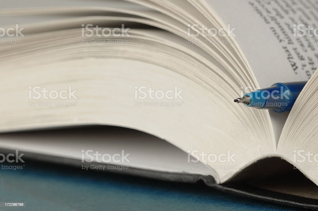 Open book with pen royalty-free stock photo