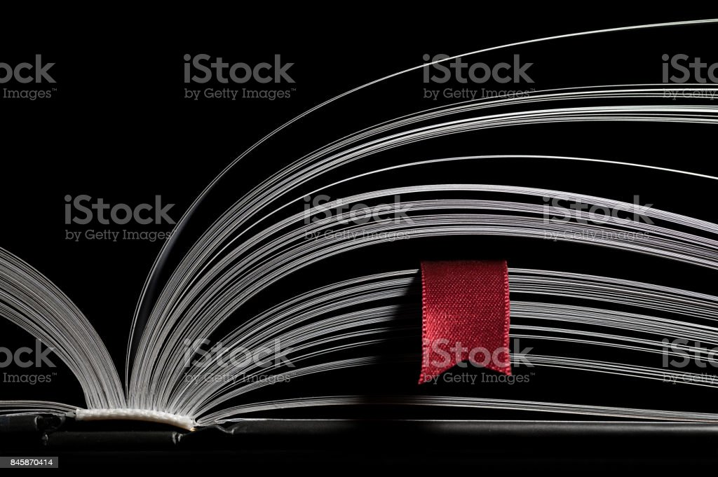 Open book with red bookmark stock photo