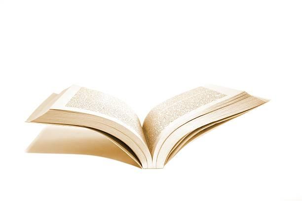Livro aberto com sombra Isolado no branco - foto de acervo
