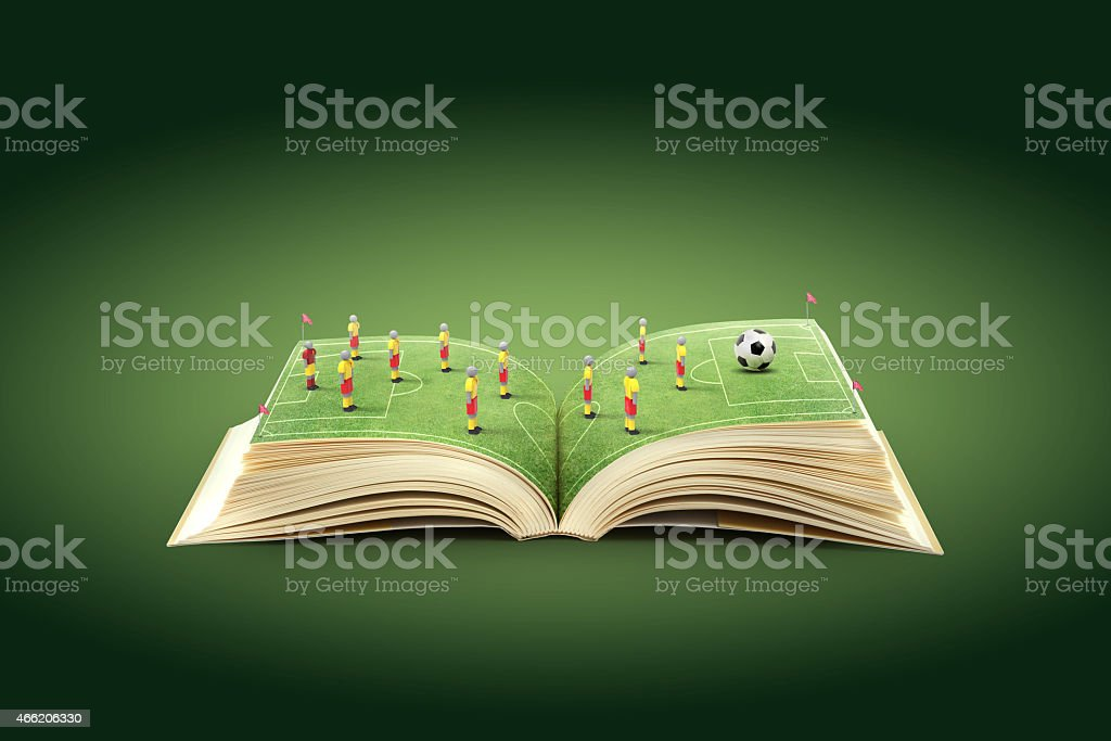 Open book with soccer field as the pages  stock photo