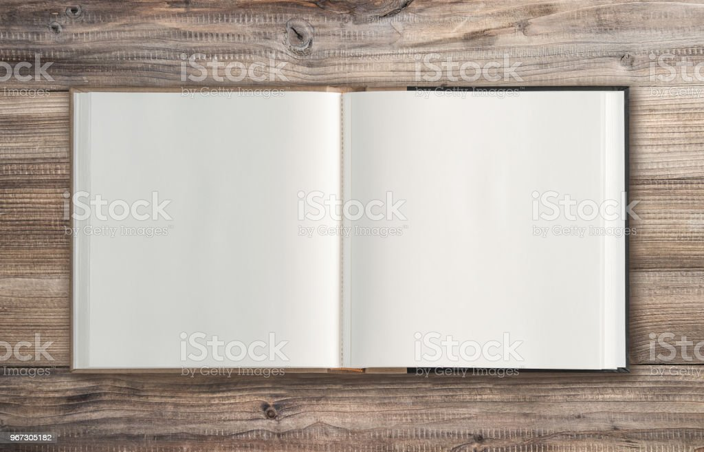 Open book wooden background Minimal flat lay stock photo