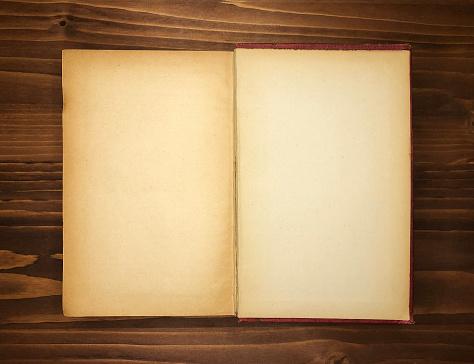 Open book wooden background