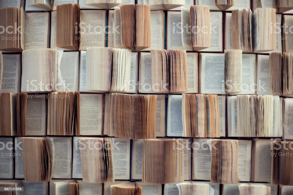 Open books, Abstract blur and defocused bookshelf in library interior for background stock photo