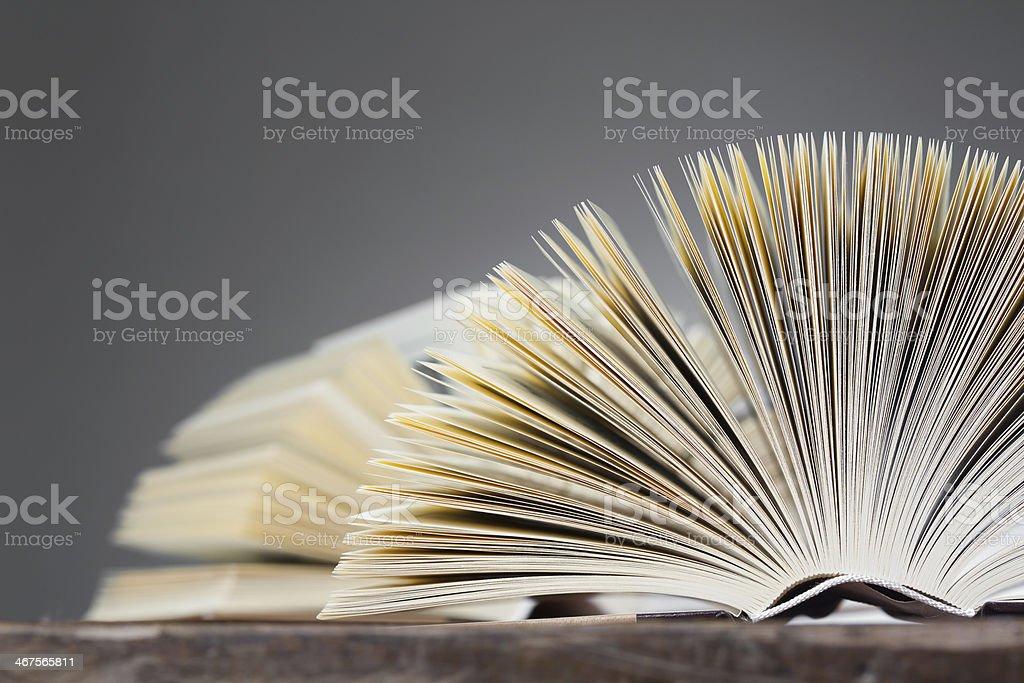 Open Books, Fan Shape on a wooden Table stock photo