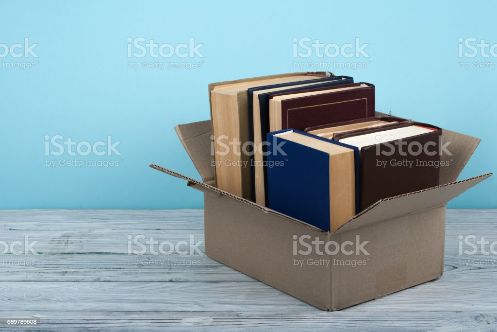 Open books on on wooden deck table and blue background. Back to School. Education concept with copy space for your ad text stock photo