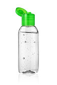 Open bottle of hand sanitizer or antiseptic gel isolated on white background