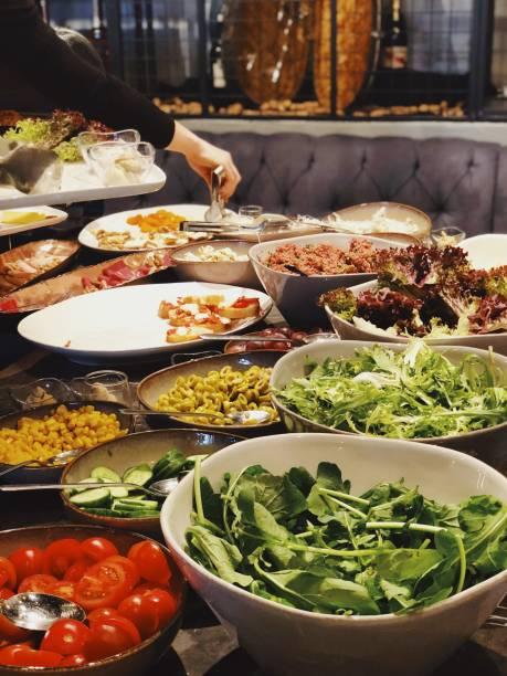 Open buffet of fresh salad and aperitifs stock photo