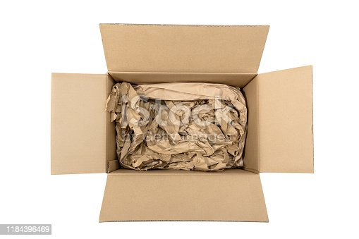 800345184 istock photo Open Cardboard box with paper filler 1184396469