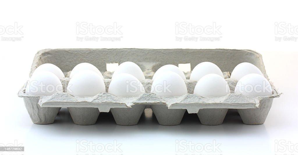 Open carton of a dozen white eggs stock photo